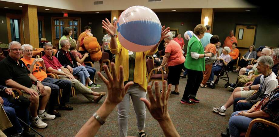 Beach balls being bounce around at the Interfaith Care Partners outreach session for Alzheimer's and other disabled people during an entertaining day of arts/crafts activities at Lakewood United Methodist Church Oct. 10, 2016, in Spring. ( James Nielsen / Houston Chronicle ) Photo: James Nielsen, Staff / © 2016  Houston Chronicle