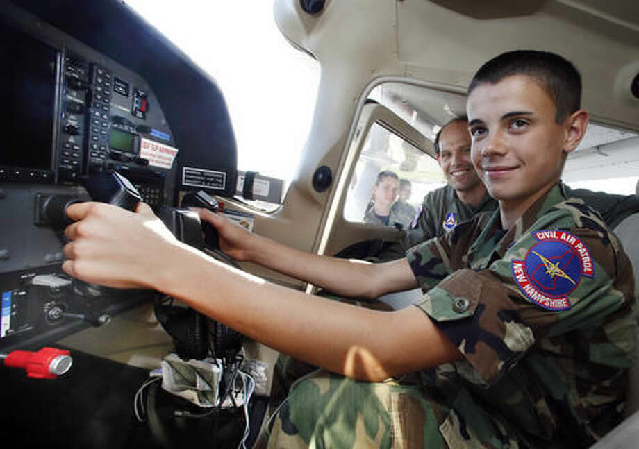 In this photo taken Wednesday Sept. 7, 2016, Civil Air Patrol cadet Michael Howry sits at the controls with Maj. Rangi Keen at the Mount Washington Regional airport in Whitefield, N.H. A renewed interest in flying has led to the return of a volunteer Civil Air Patrol unit in northern New Hampshire. (AP Photo/Jim Cole)