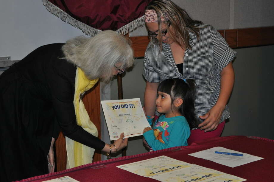 TAMIU's Dean of the College of Education Catheryn Weitman congratulates a young reader at last year's Read 3 Family Literacy Program Graduation Ceremony.