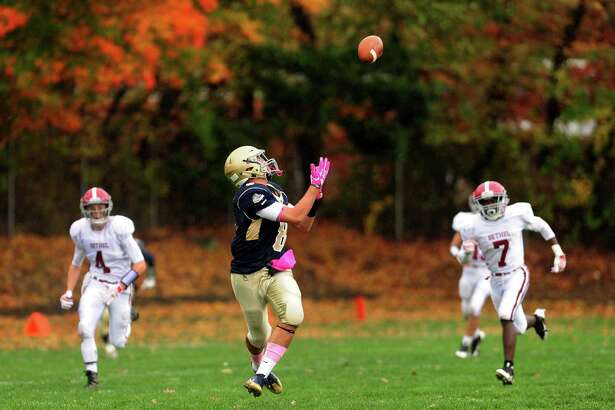 Notre Dame of Fairfield's Mike Bevino receives a pass which he carried to the endzone to score during high school football action against Bethel in Fairfield, Conn. on Saturday Oct. 22, 2016.