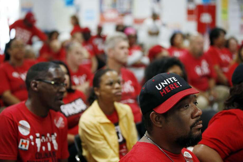 Culinary union members rally before heading out to encourage voters to cast ballots in Las Vegas. For many of the union workers, the vote is personal; they are fighting the boss. Photo: Isaac Brekken, Special To The Chronicle