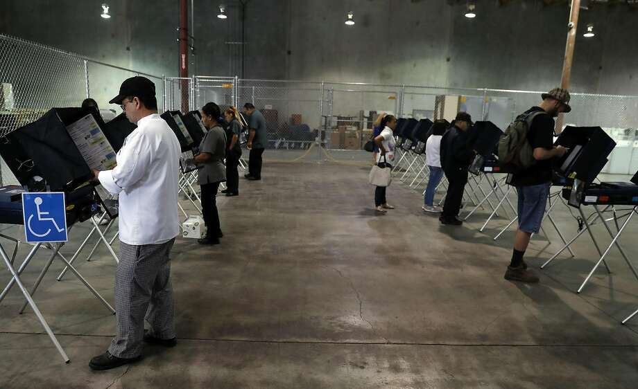 Voters cast their ballots at an early voting polling place in Las Vegas. Photo: Isaac Brekken, Special To The Chronicle