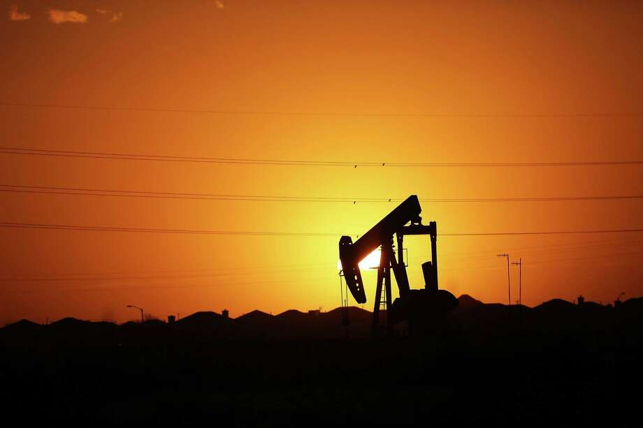 A pumpjack sits on the outskirts of town at dawn in the Permian Basin oil field on January 21, 2016 in the oil town of Midland, Texas. Despite recent drops in the price of oil, many residents of Andrews, and similar towns across the Permian, are trying to take the long view and stay optimistic. The Dow Jones industrial average plunged 540 points on Wednesday after crude oil plummeted another 7% and crashed below $27 a barrel.  (Photo by Spencer Platt/Getty Images) Photo: Spencer Platt, Staff / Getty Images / 2016 Getty Images
