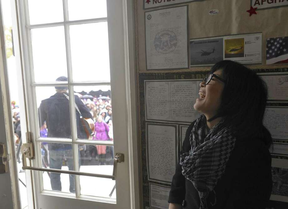 "Actress Keiko Agena, who plays ""Lane"" on the tv show ""Gilmore Girls"" listens to cast mate Todd Lowe, ""Zach"", perform on the front steps of Bryan Memorial Town Hall in Washington Depot during Gilmore Girls Fan Fest on Saturday. Photo: H John Voorhees III / Hearst Connecticut Media / The News-Times"