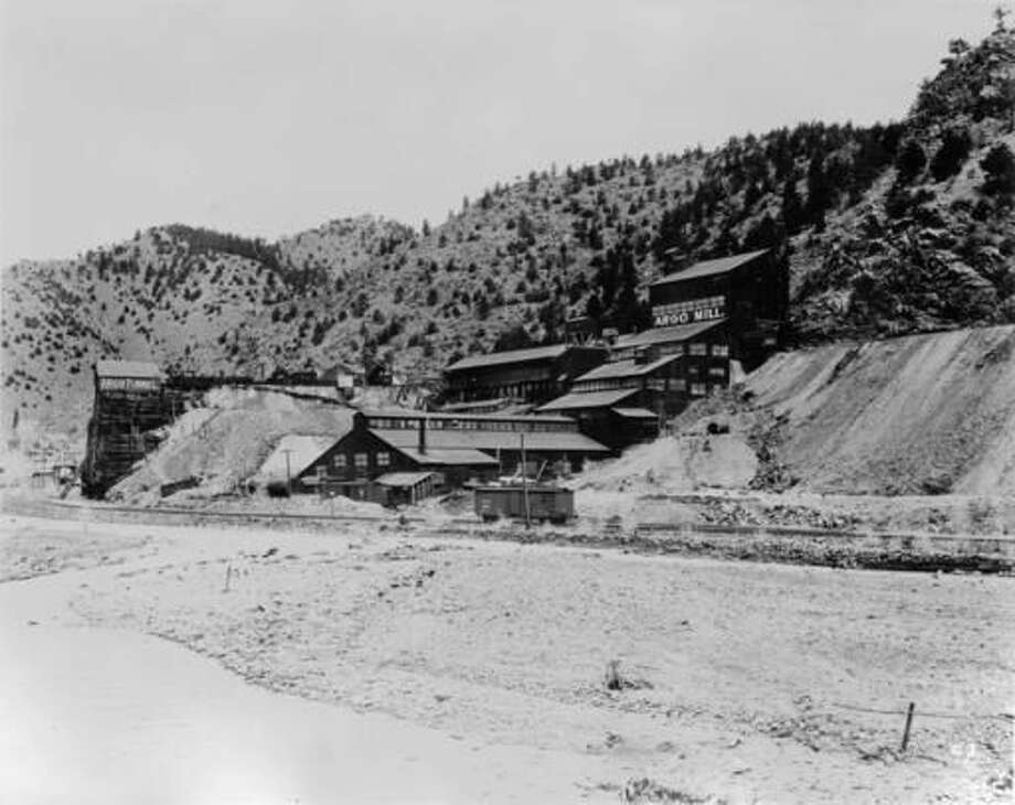This undated photo from the Denver Public Library Western History Collection shows the Argo Mill and Tunnel complex in Idaho Springs, Colo. The mill and tunnel complex are part of an extensive Superfund cleanup. (Denver Public Library via AP)