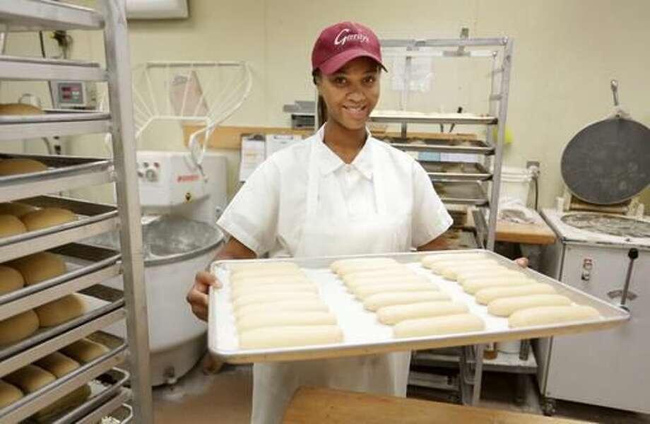 In this Thursday, Sept 1, 2016 photo, Shelby Rabb, head baker at Gerrity's works on producing baked goods in Scranton, Pa. Jake Danna Stevens /The Times & Tribune via AP)