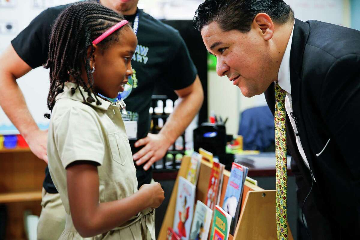New Houston Independent School District Superintendent Richard Carranza, right, talks to Law Elementary School second grader Jayla Howard, 7, as he visits schools around the district for the first day of school Monday, August 22, 2016 in Houston. ( Michael Ciaglo / Houston Chronicle )