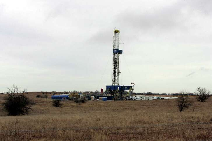 A natural gas drilling site west of Ponder, Texas is shown surrounded by grassy scrubland, Friday, Jan. 3, 2006. The rig is located on the 5,000-square-mile Barnett Shale reservoir. (AP Photo/Donna McWilliam)