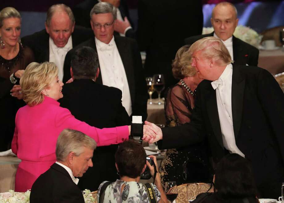 Hillary Clinton shakes hands with Donald Trump while attending the annual Alfred E. Smith Memorial Foundation Dinner at the Waldorf Astoria on October 20, 2016 in New York City. Photo: Spencer Platt, Staff / 2016 Getty Images
