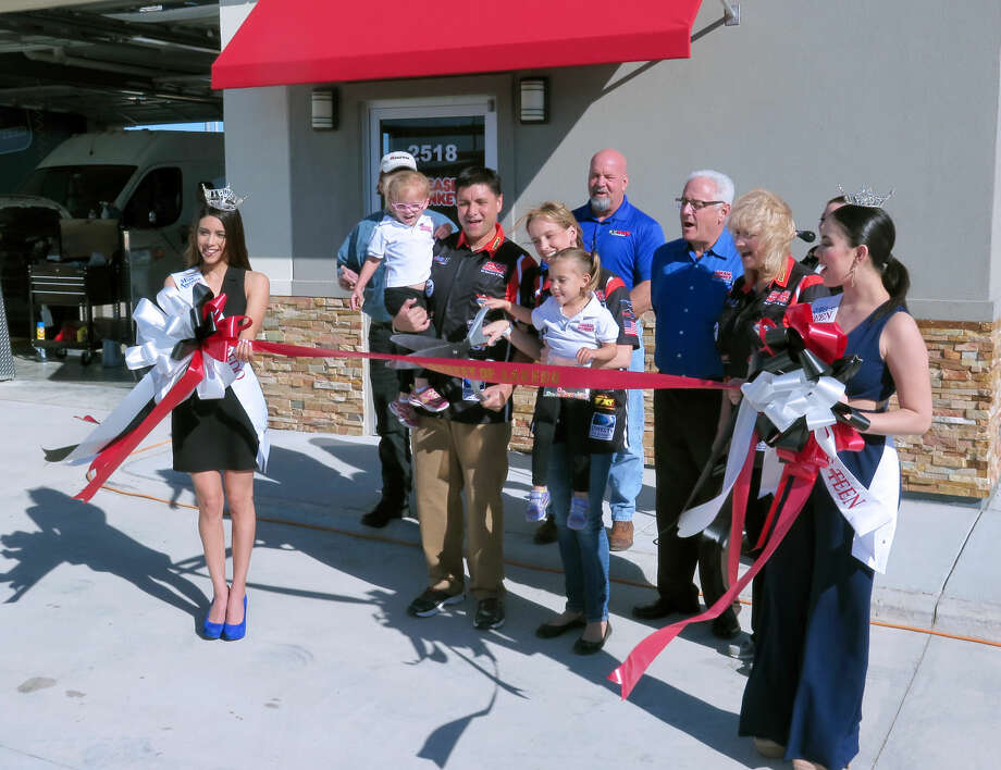 Owners Robert and Amy Rodriguez and their daughters cut the ribbon for Grease Monkey of Laredo Friday morning. The business is located at 2518 Bob Bullock Loop, west of International Boulevard.