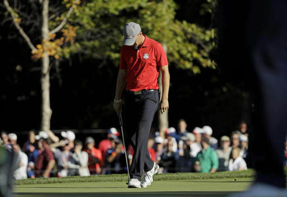 United States' Jordan Spieth reacts after a missed putt on the 13th hole during a four-balls match at the Ryder Cup golf tournament Friday, Sept. 30, 2016, at Hazeltine National Golf Club in Chaska, Minn. (AP Photo/David J. Phillip)