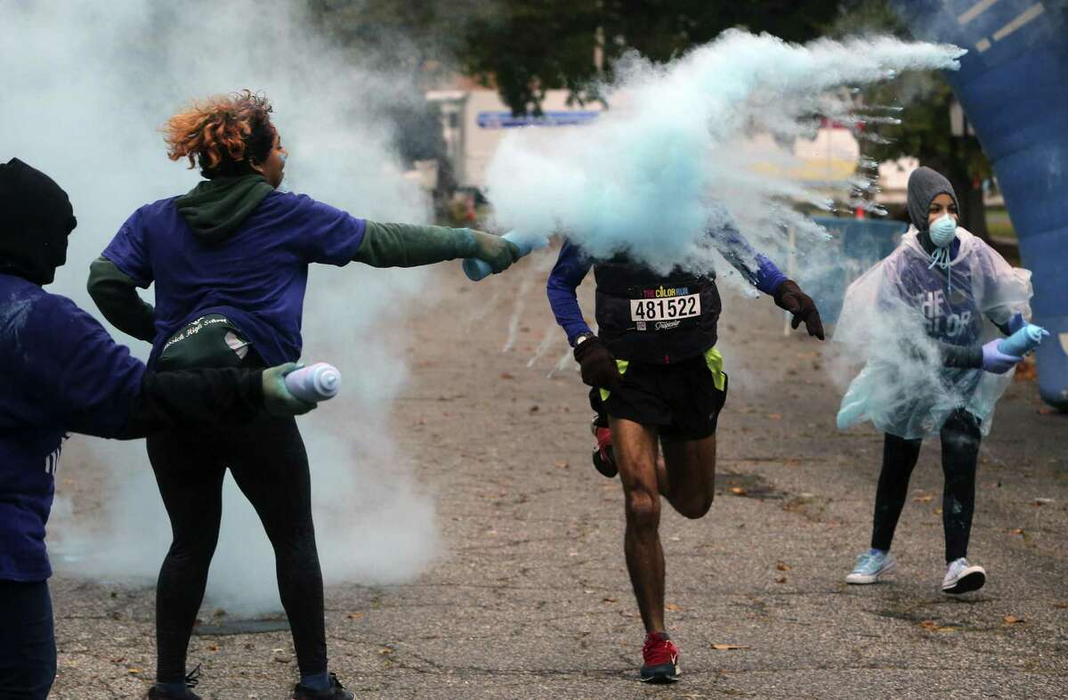 A good crowd showed up in the rain to be doused in colored powder during the 5K Color Run through Seaside Park in Bridgeport, Conn. on Saturday, Oct. 22, 2016.