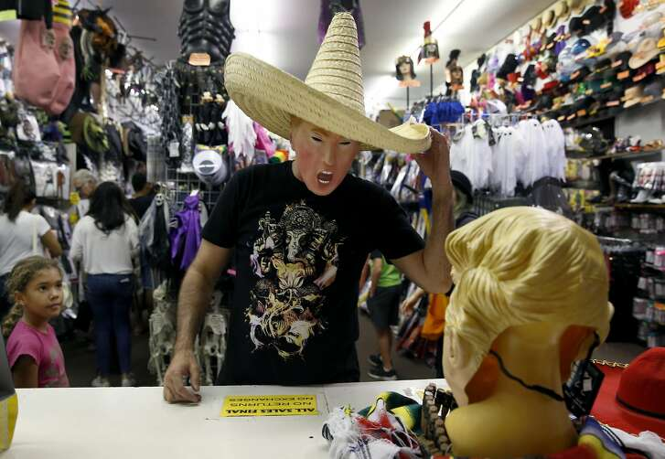 "Jay Franco tries on a Donald Trump ""Bad Hombre"" Halloween costume at House of Humor in Redwood City, Calif. on Saturday, Oct. 22, 2016."