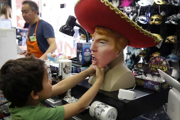 3of 3ben tsatsos 6 fiddles with a donald trump bad hombre halloween costume at house of humor in redwood city calif on saturday oct 22 2016