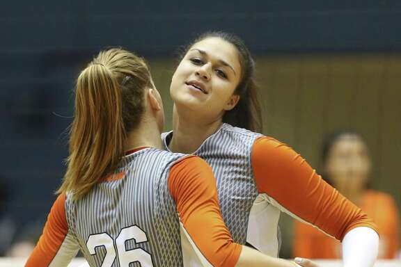 University of Texas at San Antonio volleyball player, Marijeta Runjic, right, of Trogir, Croatia, chest bumps with Antonela Jularic, of Vrbovec Croatia, during their series against the University of Texas at El Paso, Sunday, Oct. 16, 2016.