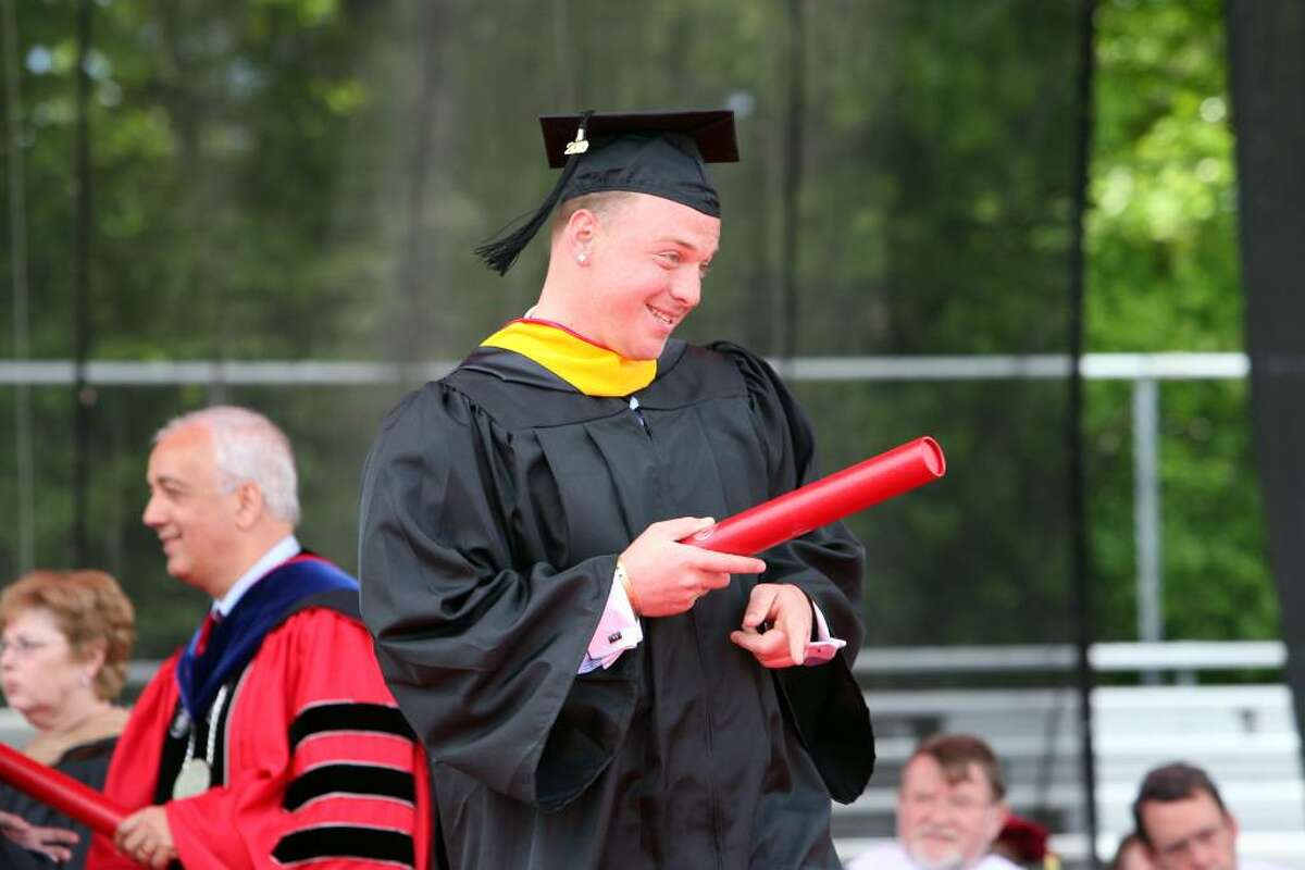 Ryan Lynch, of New York, receives his degree at Sacred Heart University's Commencement ceremony on Sunday.