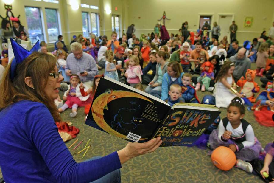 William K. Sanford Town Library children's librarian Cristine Saxe reads a book as part of Halloween at The Crossings on Saturday Oct. 21, 2016 in Colonie , N.Y.  (Michael P. Farrell/Times Union) Photo: Michael P. Farrell / 20038507A