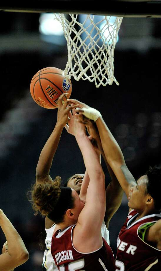 Emmanuella Edoka of Siena, background, battles for an offensive rebound against Rider players during their MAAC Tournament game on Thursday, March 3, 2016, in Albany, N.Y.  (Paul Buckowski / Times Union) Photo: PAUL BUCKOWSKI / 10035654A