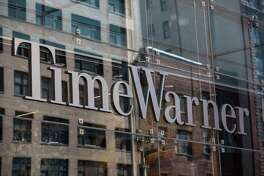 FILE - OCTOBER 22, 2016: It was reported that AT&T has reached a deal to acquire Time Warner for more than $80 billion October 22, 2016. NEW YORK, NY - MAY 26:  Time Warner Cable headquarters are seen in Columbus Circle on May 26, 2015 in New York City. Charter Communications announced this morning that it has bought Time Warner Cable for $56.7 billion.  (Photo by Andrew Burton/Getty Images)
