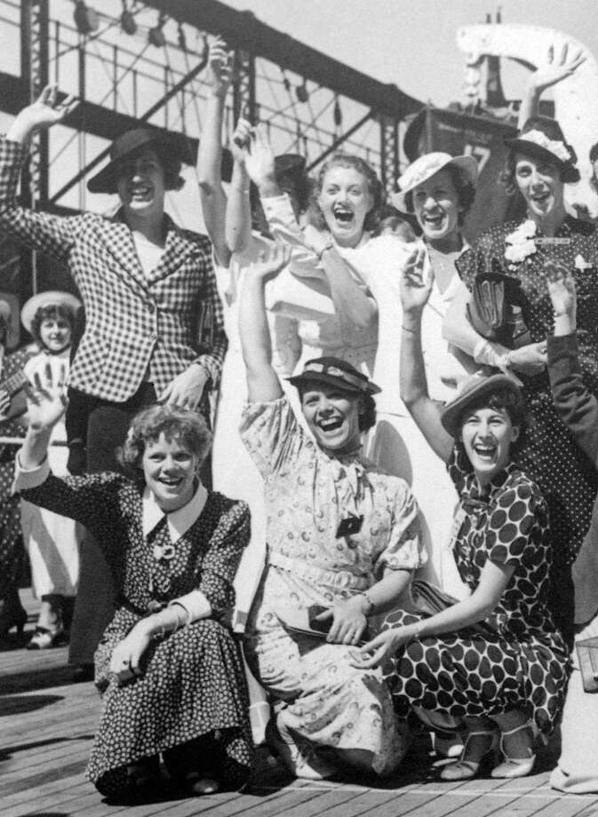 In this July 15, 1936, file photo, Simone Schaller, lower right, waves with members of the United States women's Olympic track and field team as they depart for Europe on the SS Manhattan. Schaller, an American hurdler who competed at the 1932 and 1936 Summer Games and was believed to be the oldest living Olympian, died of natural causes Thursday, Oct. 20, 2016,  in the Arcadia, Calif., home she and her husband built when they married in the 1930s, her grandson Jeffrey Hardy said, Saturday, Oct. 22, 2016. She was 104. (AP Photo/File) Photo: Associated Press