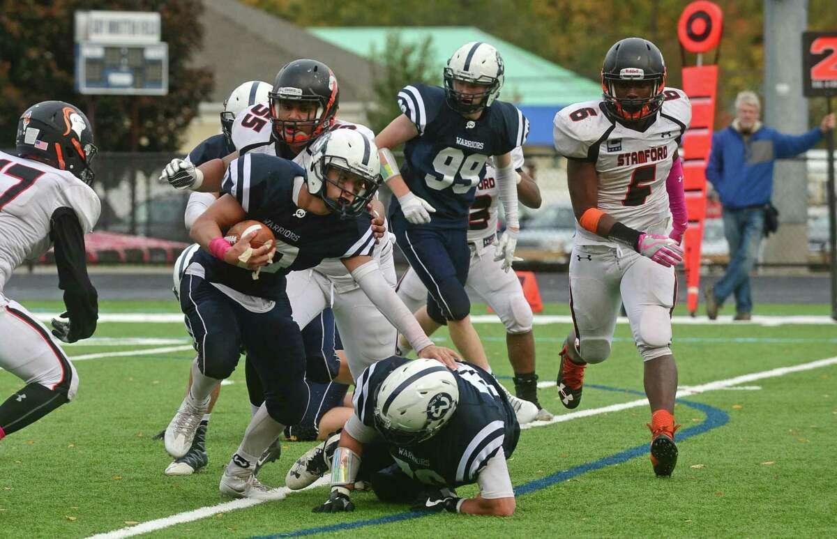 Wilton High School football player Matt D'Elisa gets by the Stamford defense during their FCIAC game at Fujitani Field in Wilton, Conn. Saturday, October 22, 2016.