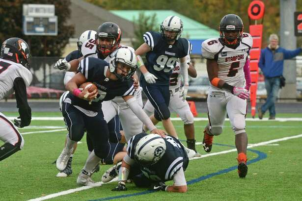 Wilton High School football player Matt D'Elisa gets by the Stamford defense during their FCIAC game at Fujitani Field in Wilton, Conn. Saturday, October 22, 2016.
