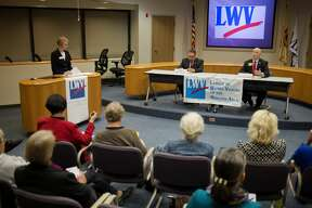 Rep. Gary Glenn, R-Midland, right, talks about his work on the  House Energy Policy Committee during a candidate forum with Democratic candidate for Michigan's 98th House District, Geoff Malicoat at Midland City Hall Council Chambers Oct 3. The forum was hosted by the League of Women Voters of the Midland Area.