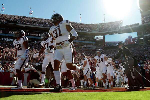 Texas A&M Aggies run out on the field before the start of a college football game at Bryant-Denny Stadium, Saturday,Oct. 22, 2016 in Tuscaloosa.