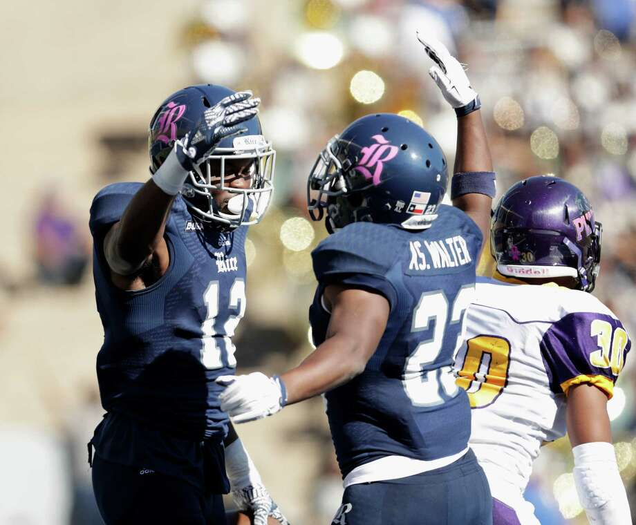 Rice Owls wide receiver Temi Alaka (12) celebrates with Rice Owls wide receiver Aston Walter (23) after a touchdown in the second quarter during the NCAA football game between the Prairie View A&M Panthers and the Rice Owls at Rice Stadium in Houston, TX on Saturday, October 22, 2016.   The Owls lead the Panthers 45-14 at halftime. Photo: For The Chronicle / Houston Chronicle
