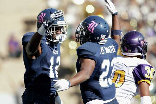 Rice Owls wide receiver Temi Alaka (12) celebrates with Rice Owls wide receiver Aston Walter (23) after a touchdown in the second quarter during the NCAA football game between the Prairie View A&M Panthers and the Rice Owls at Rice Stadium in Houston, TX on Saturday, October 22, 2016.   The Owls lead the Panthers 45-14 at halftime.