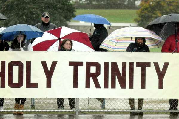 Holy Trinity fans brave the weather to support their team in the Class C quarterfinal football game against Hoosic Valley on Saturday, Oct. 22, 2016, at Hoosic Valley High in Schaghticoke, N.Y. (Cindy Schultz / Times Union)