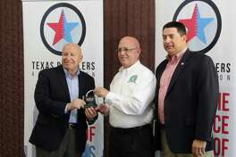 Congressman Kevin Brady (left) accepts the 'Hero of Main Street' award from the National Retail Federation.