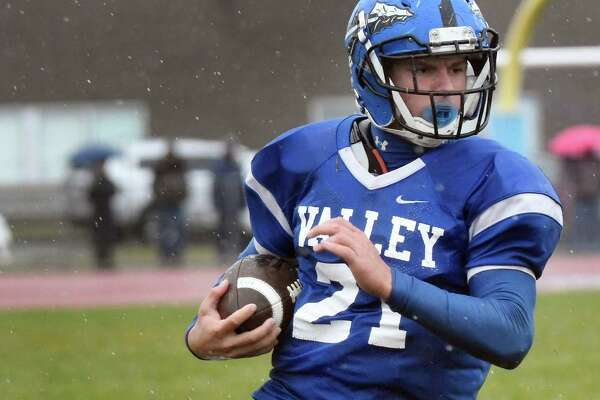 Hoosic Valley's Isaac Tom Madigan carries the ball during their Class C quarterfinal football game against Holy Trinity on Saturday, Oct. 22, 2016, at Hoosic Valley High in Schaghticoke, N.Y. (Cindy Schultz / Times Union)