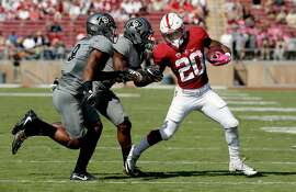 Colorado's Anthony Julmisse, 9 and Chidobe Awuzi,4  chase after Stanford's Bryce Love, 20 on a run for a first down in the first quarter, as Stanford takes on the Colorado at Stanford Stadium in PAC 12 football action on Saturday October 22, 2016, in Stanford, California.