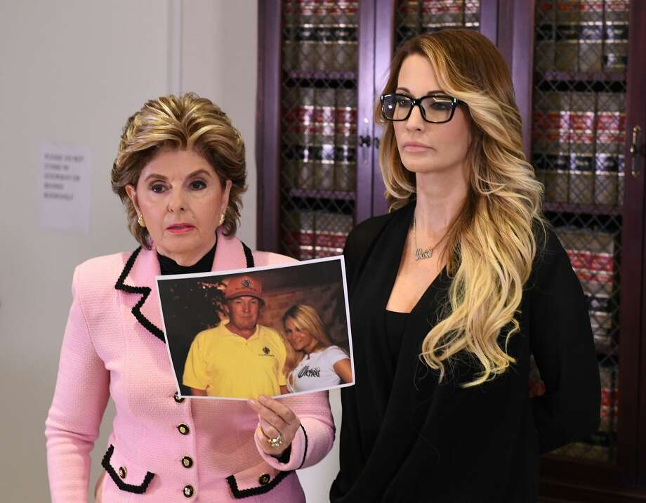 Jessica Drake (R), who works for an adult film company, speaks beside attorney Gloria Allred (L) about allegations of sexual misconduct against Republican presidential hopeful Donald Trump during a press conference in Los Angeles, California on October 22, 2016.  / AFP / Mark RALSTON        (Photo credit should read MARK RALSTON/AFP/Getty Images) Photo: Getty Images