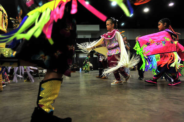 Dancers make their way round the circle during the inaugural Native American Inter-Tribal PowWow held Saturday at the Civic Center in Beaumont. Music, dancing, food, and vendor's booths offering a number of items reflecting Native American culture rounded out the day-long event, which was held in honor of all veterans. Photo taken Saturday, October 22, 2016 Kim Brent/The Enterprise