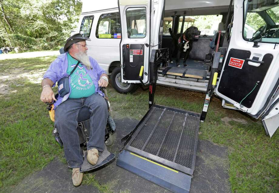 James Van Winkle prepares to load into his wheelchair lift van as his service dog, Roku, waits inside shown Wednesday, Sept. 14, 2016, in Conroe.  ( Melissa Phillip / Houston Chronicle ) Photo: Melissa Phillip, Staff / © 2016 Houston Chronicle
