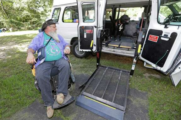 James Van Winkle prepares to load into his wheelchair lift van as his service dog, Roku, waits inside shown Wednesday, Sept. 14, 2016, in Conroe.  ( Melissa Phillip / Houston Chronicle )