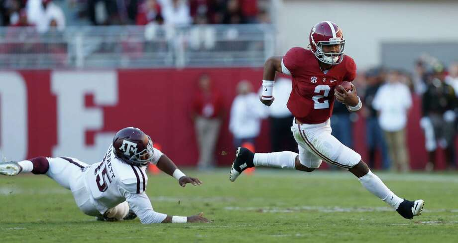 Alabama Crimson Tide quarterback Jalen Hurts (2) runs the ball as Texas A&M Aggies defensive lineman Myles Garrett (15) tried to stop him during the third quarter of a college football game at Bryant-Denny Stadium, Saturday,Oct. 22, 2016 in Tuscaloosa. Photo: Karen Warren, Houston Chronicle / 2016 Houston Chronicle