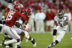 Texas A&M Aggies running back Trayveon Williams (5) tries to gain yardage against Alabama's defense during the fourth quarter of a college football game at Bryant-Denny Stadium, Saturday,Oct. 22, 2016 in Tuscaloosa.