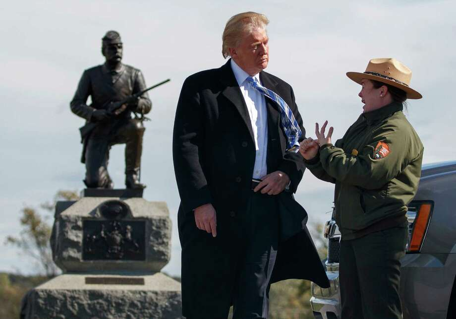 Interpretive park ranger Caitlin Kostic speaks to Republican presidential candidate Donald Trump as she gives him a tour at Gettysburg National Military Park Saturday, Oct. 22, 2016, in Gettysburg, Pa. (AP Photo/ Evan Vucci) ORG XMIT: PAEV129 Photo: Evan Vucci / Copyright 2016 The Associated Press. All rights reserved.