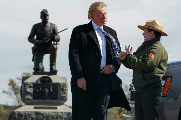 Interpretive park ranger Caitlin Kostic speaks to Republican presidential candidate Donald Trump as she gives him a tour at Gettysburg National Military Park Saturday, Oct. 22, 2016, in Gettysburg, Pa. (AP Photo/ Evan Vucci) ORG XMIT: PAEV129