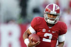 Alabama Crimson Tide quarterback Jalen Hurts (2) on his 27-yard run for a touchdown as during the fourth quarter of a college football game at Bryant-Denny Stadium, Saturday,Oct. 22, 2016 in Tuscaloosa.
