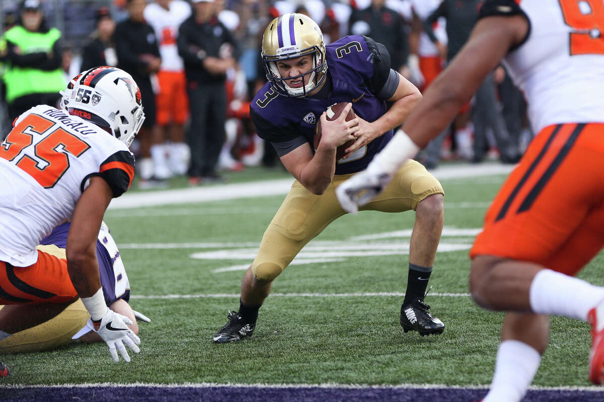 Washington's Jake Browning runs the ball in for a touchdown in the first half of an NCAA football game against Oregon State at Husky Stadium on Saturday, Oct. 22, 2016. (GRANT HINDSLEY, seattlepi.com)