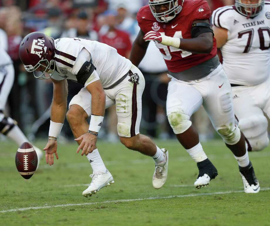 Texas A&M Aggies quarterback Trevor Knight (8) looses control of the ball during the fourth quarter of a college football game at Bryant-Denny Stadium, Saturday,Oct. 22, 2016 in Tuscaloosa. Photo: Karen Warren, Houston Chronicle / 2016 Houston Chronicle