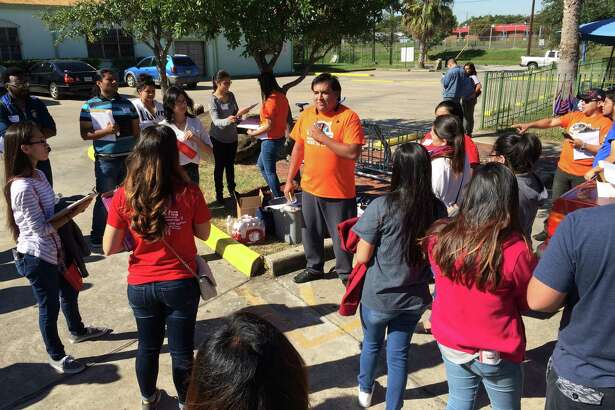 Daniel Olvera, an organizer with United We Dream, prepared volunteers to canvass Houston's East End to raise awareness of a controversial immigration enforcement program.