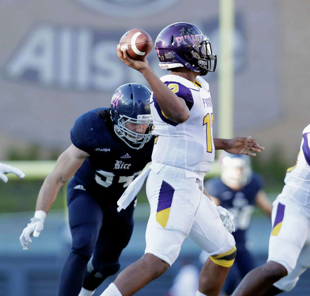 Prairie View A&M Panthers quarterback Jalen Morton (12) is pressured by Rice Owls defensive end Graysen Schantz (94) as he looks to pass in the fourth quarter during the NCAA football game between the Prairie View A&M Panthers and the Rice Owls at Rice Stadium in Houston, TX on Saturday, October 22, 2016. The Owls defeated the Panthers 65-44.