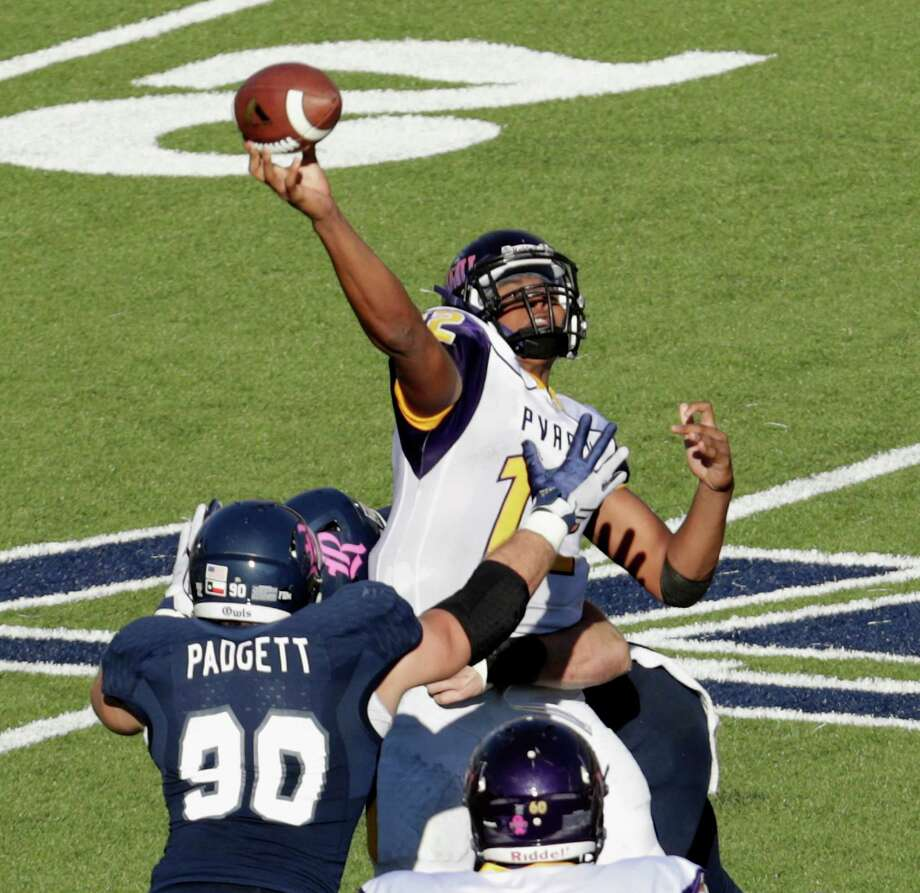 Prairie View A&M Panthers quarterback Jalen Morton (12) throws a pass under pressure by Rice Owls defensive end Blain Padgett (90) in the third quarter during the NCAA football game between the Prairie View A&M Panthers and the Rice Owls at Rice Stadium in Houston, TX on Saturday, October 22, 2016.   The Owls defeated the Panthers 65-44. Photo: Tim Warner, For The Chronicle / Houston Chronicle