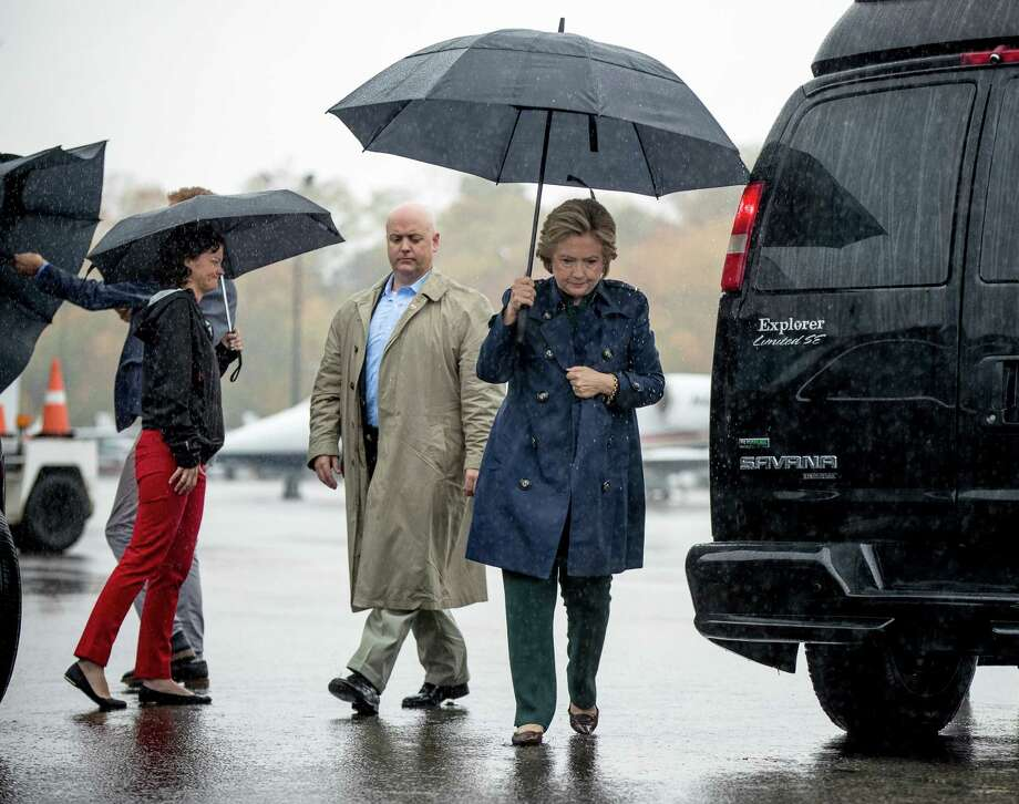 Democratic presidential candidate Hillary Clinton arrives to board her campaign plane at Westchester County Airport in White Plains, N.Y., Friday, Oct. 21, 2016, to travel to Cleveland for a rally. (AP Photo/Andrew Harnik) ORG XMIT: NYAH102 Photo: Andrew Harnik / Copyright 2016 The Associated Press. All rights reserved.