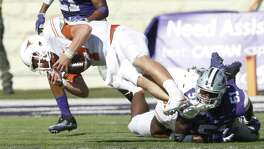 Texas quarterback Shane Buechele (7) is sacked after fumbling near the goal line during an NCAA college football game against Kansas State, Saturday, Oct. 22, 2016, in Manhattan, Kan. Buechele recovered the ball. (Bo Rader/The Wichita Eagle via AP)